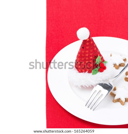 Christmas table setting on a red napkin, isolated on white - stock photo