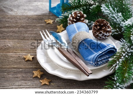Christmas table setting on a wooden background, horizontal - stock photo