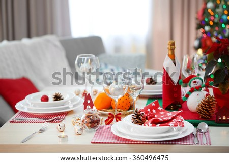 Christmas table setting on light room background