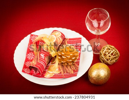 Christmas table setting on the red background.  - stock photo