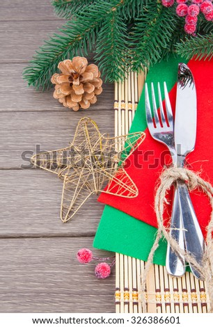 Christmas table setting, silver cutlery and winter decoration