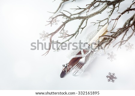 Christmas Table Setting. Vintage Fork and Knife with Silver Holiday Decorations over Light Background. Selective Focus. Space for Text.  - stock photo