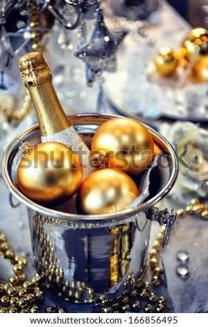 Christmas table setting with champagne  - stock photo