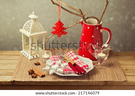 Christmas table setting with christmas decorations and candles - stock photo