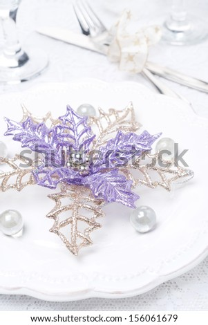 Christmas table setting with decorating, selective focus, close-up - stock photo