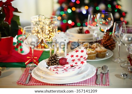 Christmas table setting with holiday decorations - stock photo