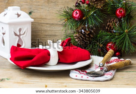 Christmas table setting with vintage silverware and pine tree branch in vase and blue christmas balls on the rustic background - stock photo