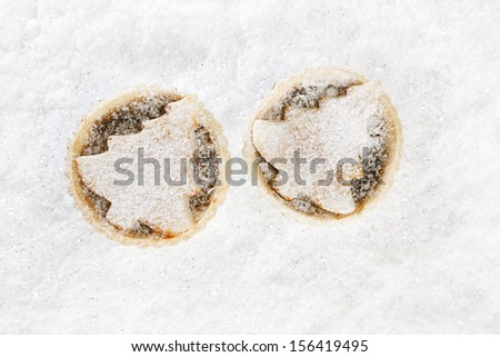 christmas  tart with marzipan tree on white snow festive background - stock photo