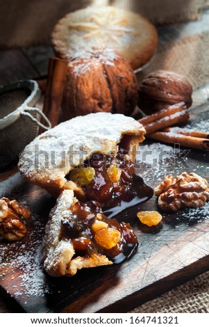 Christmas tarts with cinnamon, walnuts and raisins - stock photo
