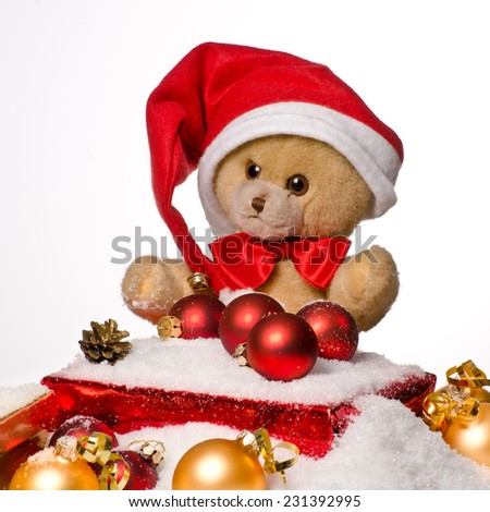 Christmas teddy bear with Red Hat and gift - stock photo