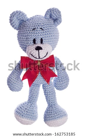 christmas teddy bear with red ribbon as a gift