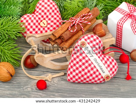 Christmas textile hearts and gift box on a gray wooden  background. A Christmas background with space for the text.