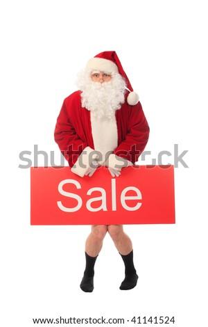 Christmas theme: happy Santa holding sale sign, isolated over white background. - stock photo