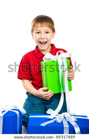 Christmas theme: little boy with a gift over white - stock photo