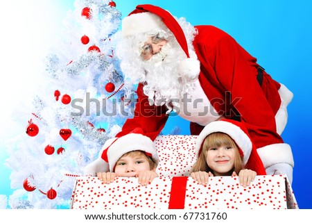 Christmas theme: Santa Claus and children having a fun.