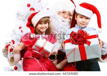 Christmas theme: Santa Claus and children having a fun. Isolated over white background. - stock photo