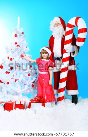 Christmas theme: Santa Claus and little girl. - stock photo