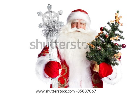 Christmas theme: Santa Claus holding christmas tree and his bag full of gifts over white background