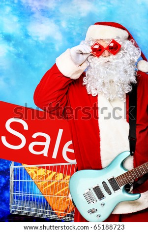 Christmas theme: Santa claus playing a guitar, snowy design. - stock photo