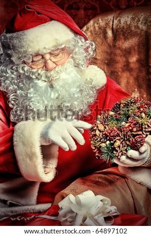 Christmas theme: Santa gifts, ina a interior. - stock photo