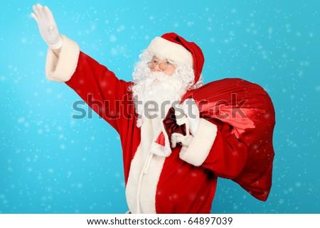 Christmas theme: Santa gifts, snowy design - stock photo