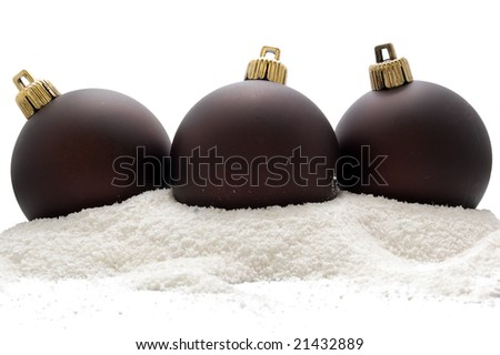 Christmas three deep brown balls in snow, isolated on white background - stock photo