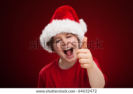 Christmas time - boy showing OK sign