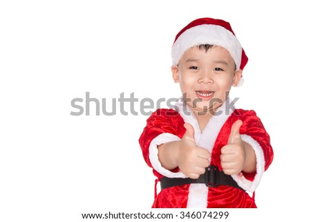 Christmas time - boy with Santa Claus Hat. Young boy as Santa Claus showing OK sign isolated on white background - stock photo