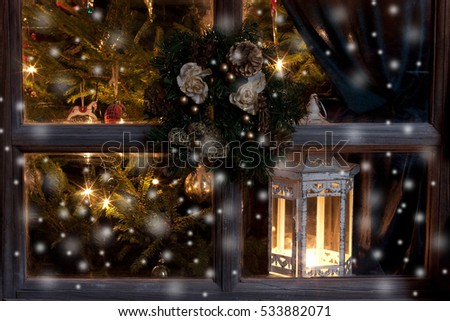 Christmas time composition   with  lights  near  window