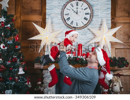Christmas time. Father and daughter in the New Year decorations - stock photo