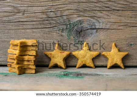 Christmas time star shaped cookies on the rustic wooden background