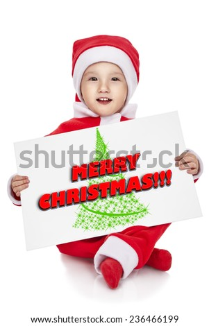 Christmas time: Sweet baby wearing a Santa costume, smiling and holding a sign, isolated on white