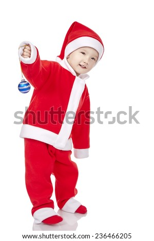 Christmas time: Sweet baby wearing a Santa costume, smiling and holding a sign, isolated on white - stock photo