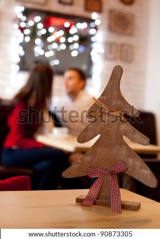 Christmas time. Young couple in cafe at the evening - stock photo