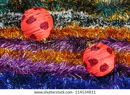 Christmas tinsel multicolored decoration with red balls - stock photo