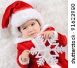 Christmas toddler in Santa hat - stock photo