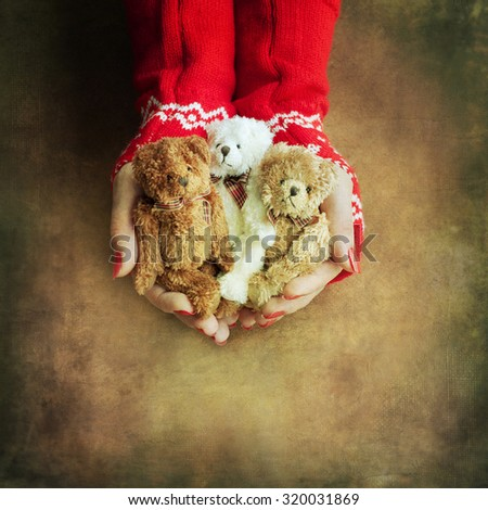 Christmas toy bear  in woman hands