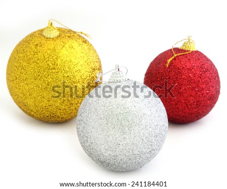Christmas toy. Red and gold balls on a white background - stock photo