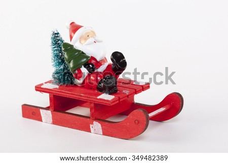 Christmas toy Santa Claus with tree  on a white background - stock photo
