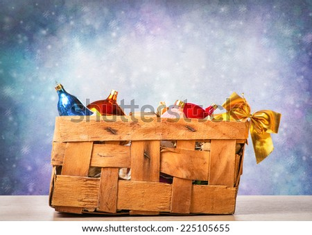 Christmas toys in an old box - stock photo