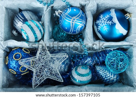 Christmas toys in wooden box close-up - stock photo