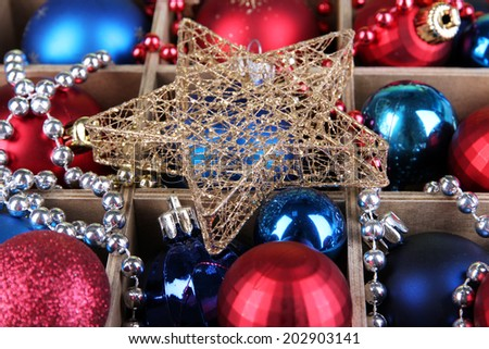 Christmas toys in wooden box close-up background