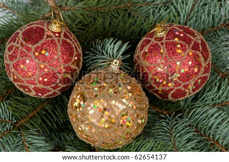 Christmas toys on branches of a fur-tree. Celebratory background - stock photo