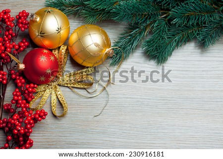 Christmas toys with spruce and european holly - stock photo