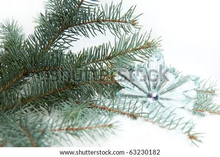 Christmas transparent star on a christmas tree - stock photo
