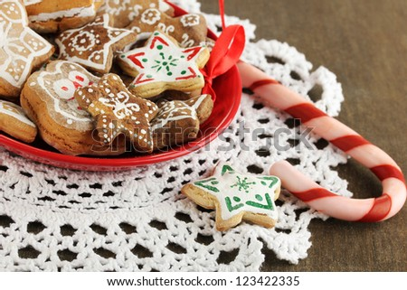 Christmas treats on plate on wooden table close-up