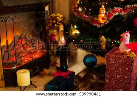 Christmas tree and Christmas decorations. Fireplace