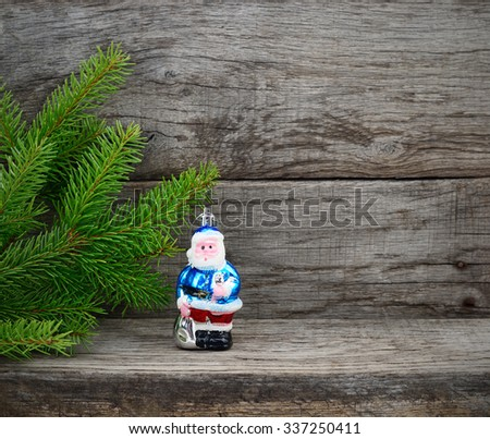 Christmas Tree and Christmas Tree and Santa Claws toy on wooden background. - stock photo