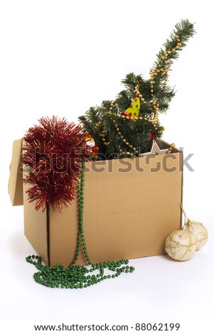 Christmas tree and decoration in a box - stock photo