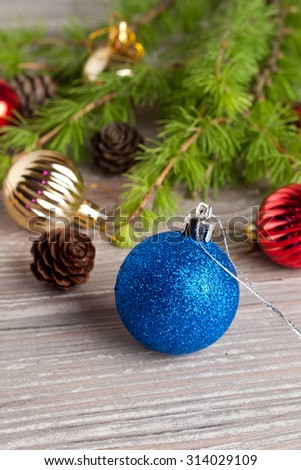 Christmas tree and decoration on a wooden background, vertical - stock photo